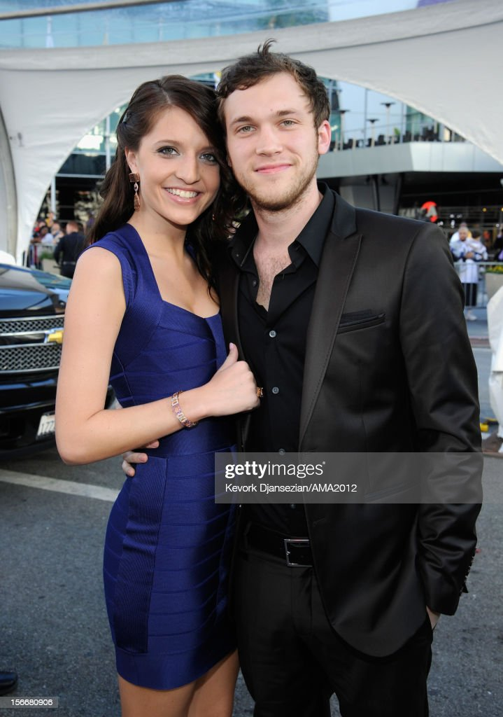 Musician Phillip Phillips (R) and Hannah Blackwell attend the 40th American Music Awards held at Nokia Theatre L.A. Live on November 18, 2012 in Los Angeles, California.