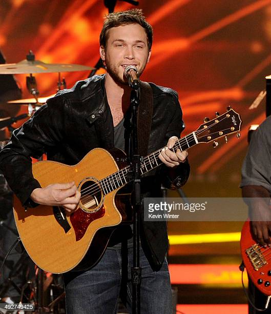 """Musician Phillip Phillips performs onstage during Fox's """"American Idol"""" XIII Finale at Nokia Theatre L.A. Live on May 21, 2014 in Los Angeles,..."""