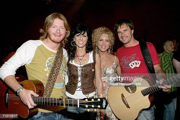 PRICING*** Musician Phillip Sweet Karen Fairchild Kimberly Roads and Jimi Westbrook of Little Big Town pose backstage during the Academy Of Country...