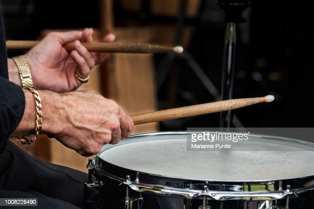 musician playing a musical instrument - music stock pictures, royalty-free photos & images
