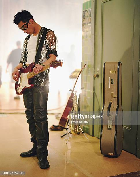 musician playing guitar backstage - guitarist stock pictures, royalty-free photos & images