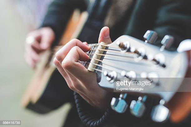 musician playing guitar - gitarre stock-fotos und bilder