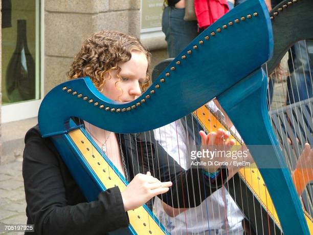Musician Playing Harp On Street