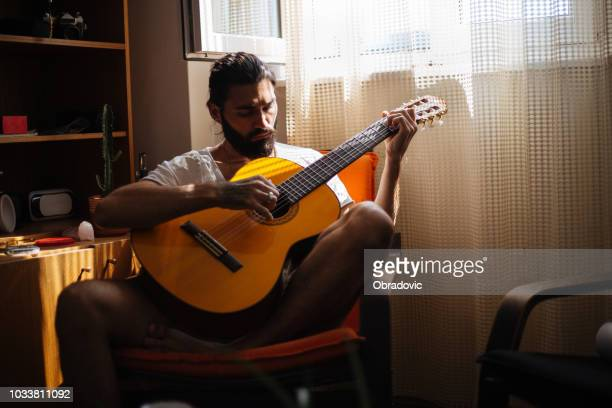 musician playing on acoustic guitar - string instrument stock photos and pictures