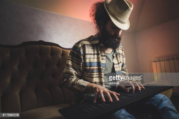 musician playing on the keyboard synthesizer - electric piano stock photos and pictures