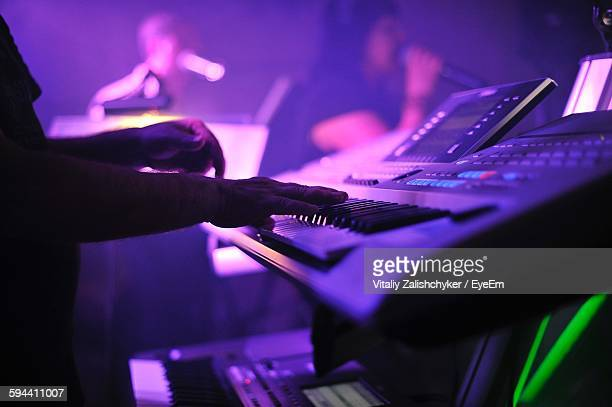 Musician Playing Piano On Stage During Concert