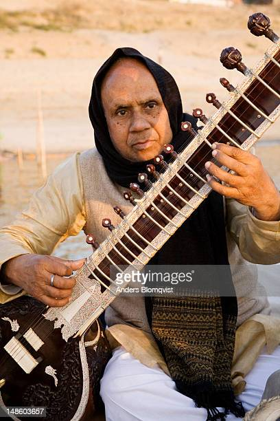 Musician playing sitar.