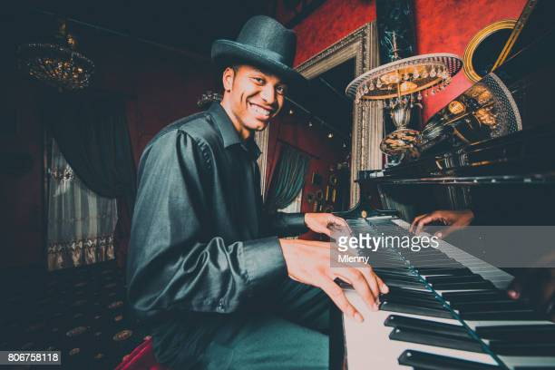 musician playing the piano in nightclub bar - grand piano stock photos and pictures