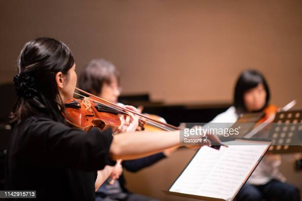 musician playing violin at classical concert - stage performance space stock pictures, royalty-free photos & images