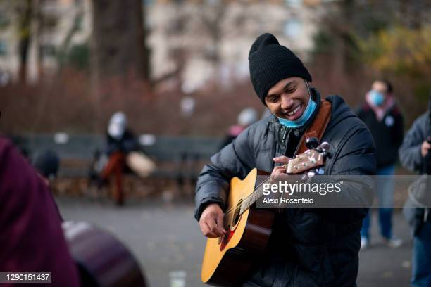 Musician plays Beatles music to honor John Lennon on the 40th anniversary of his death at Strawberry Fields, Central Park on December 08, 2020 in New...