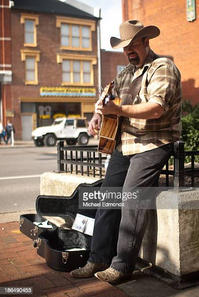 Musician plays guitar on the streets of Nashville, Tennessee