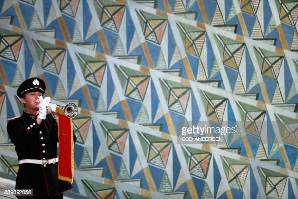 A musician plays his wind instrument at the city hall in Oslo Norway during the award ceremony of the 2017 Nobel Peace Prize on December 10 2017 The...