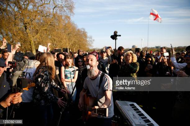 """Musician plays music to protestors during a """"Unite For Freedom"""" anti-lockdown demonstration held to protest against the use of vaccine passports in..."""