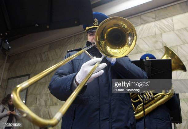 Musician plays the trumpet during the spring concert of the brass band of the 22nd Separate Brigade of the National Guard at the Teatralna metro...