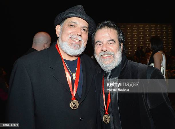Musician Poncho Sanchez and producer Moogie Canazio pose during the 2012 Person of the Year honoring Caetano Veloso at the MGM Grand Garden Arena on...