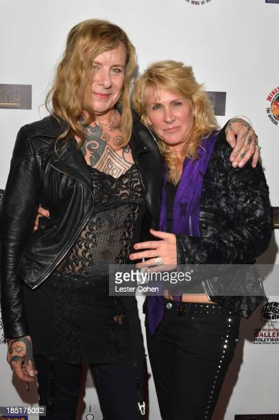 Musician Porl Thompson and photographer/author Lisa S Johnson attend '108 Rock Star Guitars' book release at Mr Musichead Gallery on October 17 2013...