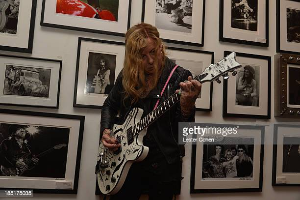 Musician Porl Thompson attends '108 Rock Star Guitars' book release at Mr Musichead Gallery on October 17 2013 in Los Angeles California