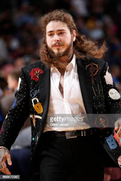 Musician Post Malone attends the Golden State Warriors game against the Dallas Mavericks on October 23 2017 at the American Airlines Center in Dallas...