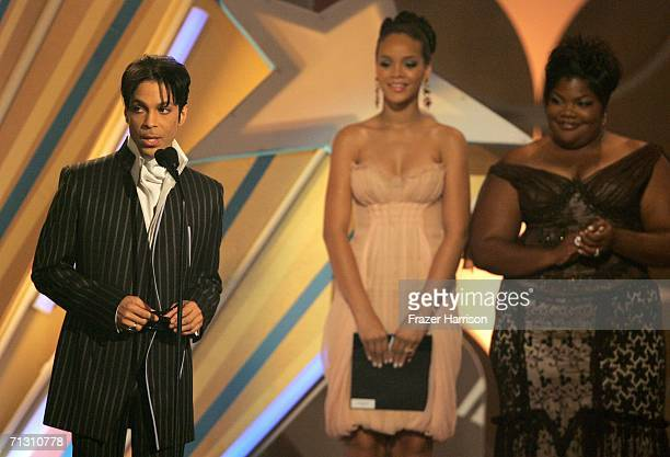 Musician Prince accepts the Male RB Award from actress Mo'Nique and singer Rihanna onstage at the 2006 BET Awards at the Shrine Auditorium on June 27...