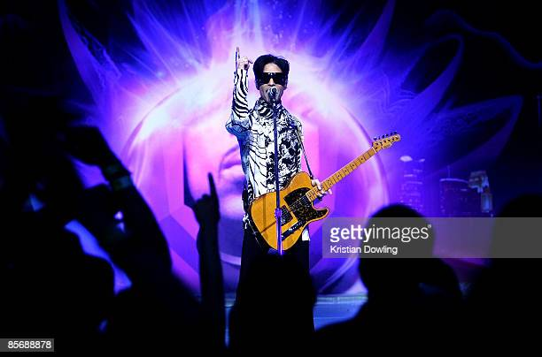 Musician Prince performs his first of three shows onstage during 'One Night Three Venues' hosted by Prince and Lotusflow3rcom held at NOKIA Theatre...