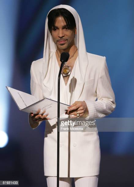 Musician Prince presents the award for 'Favorite Leading Lady' onstage during the 31st Annual People's Choice Awards at the Pasadena Civic Auditorium...
