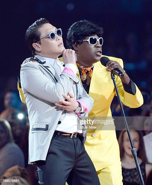 Musician Psy and Host Tracy Morgan speak onstage during the 2013 Billboard Music Awards at the MGM Grand Garden Arena on May 19 2013 in Las Vegas...
