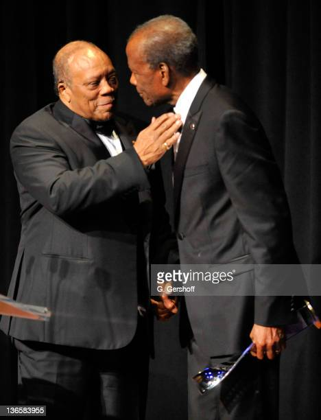 Musician Quincy Jones and honoree Sidney Poitier speak onstage at The Film Society of Lincoln Center's presentation of the 38th Annual Chaplin Award...