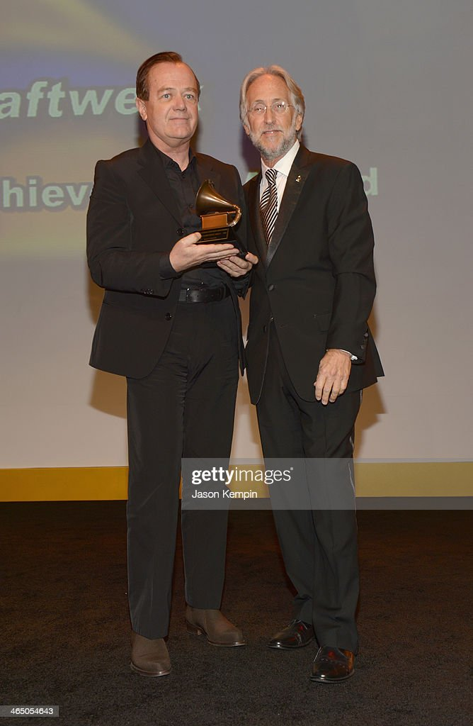 Musician Ralf Hutter and The Recording Academy president/CEO Neil Portnow attend the Special Merit Awards Ceremony as part of the 56th GRAMMY Awards on January 25, 2014 in Los Angeles, California.