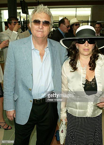 Musician Randy Newman and his wife Gretchen arrives at the 131st Kentucky Derby at Churchill Downs racetrack on May 7 2005 in Louisville Kentucky