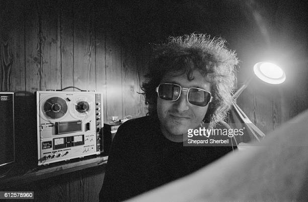 Musician Randy Newman at the piano in his home studio in Los Angeles