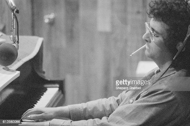 Musician Randy Newman playing the piano during recording sessions for Good Old Boys at Amigo Studios in Los Angeles