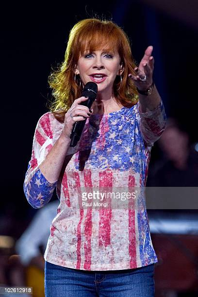 """Musician Reba McEntire performs at the annual PBS """"A Capitol Fourth"""" concert rehearsal at the US Capitol on July 3, 2010 in Washington, DC."""
