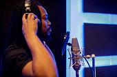 portrait black musician recording music