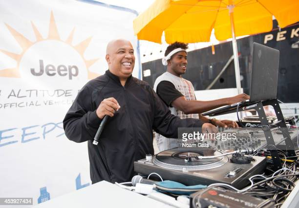 Musician Rev Run and DJ Ruckus perform at The Summer Of Jeep at South Street Seaport on August 21, 2014 in New York City.