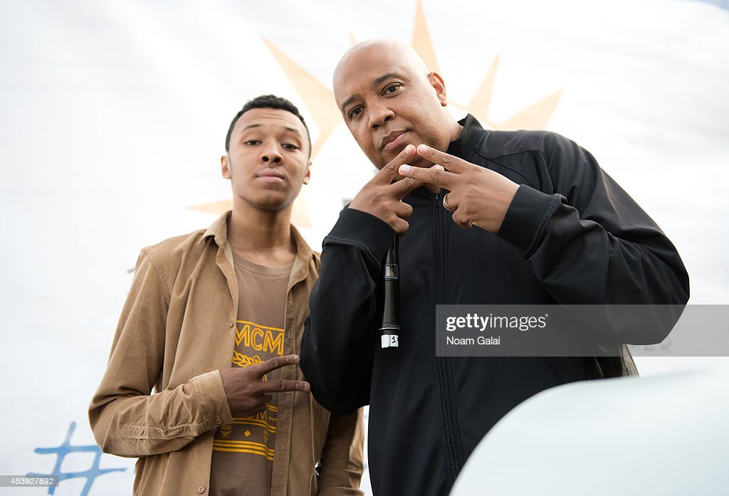 Musician Rev Run (R) attends The Summer Of Jeep at South Street Seaport on August 21, 2014 in New York City.