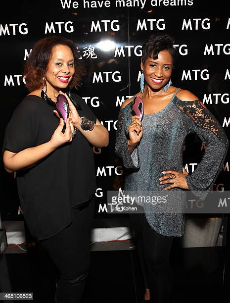 Musician Rhonda Nicole and producer Erica Taylor attend the GRAMMY Gift Lounge during the 56th Grammy Awards at Staples Center on January 25 2014 in...
