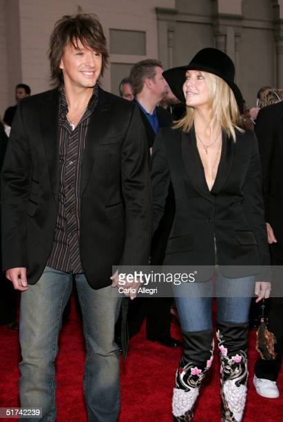 Musician Richie Sambora of Bon Jovi and wife actress Heather Locklear arrive to the 32nd Annual American Music Awards at the Shrine Auditorium...