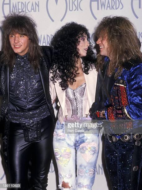 Musician Richie Sambora of Bon Jovi singer/actress Cher and musician Jon Bon Jovi of Bon Jovi attend the 15th Annual American Music Awards on January...
