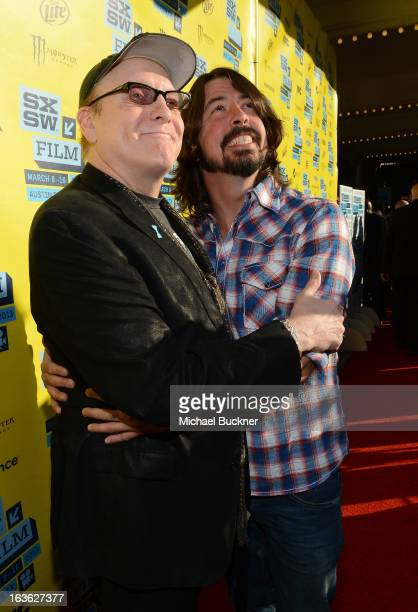 Musician Rick Nielsen and musician/director Dave Grohl arrive at the screening of Sound City during the 2013 SXSW Music Film Interactive Festival at...