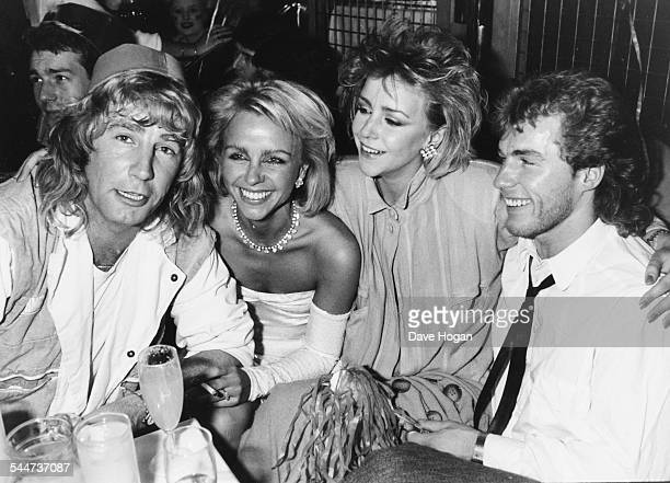Musician Rick Parfitt and actors Debbie Ash Leslie Ash and Chris Quinten celebrating the new year in London January 2nd 1985