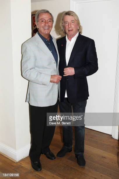 Musician Rick Parfitt visits Des O'Connor backstage at 'Dreamboats and Petticoats' at The Playhouse Theatre on November 25 2011 in London England