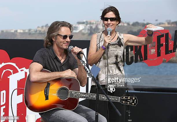 Musician Rick Springfield and KOST 1035 DJ Kari Steele attend the Rick Springfield Rocks The Boat For Ricki and the Flash event on July 30 2015 in...