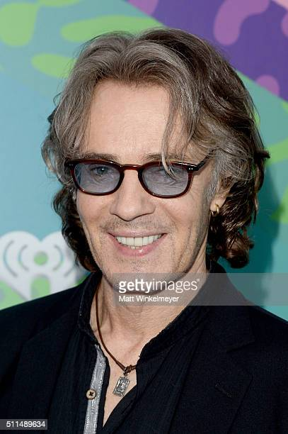 Musician Rick Springfield poses backstage during the first ever iHeart80s Party at The Forum on February 20 2016 in Inglewood California