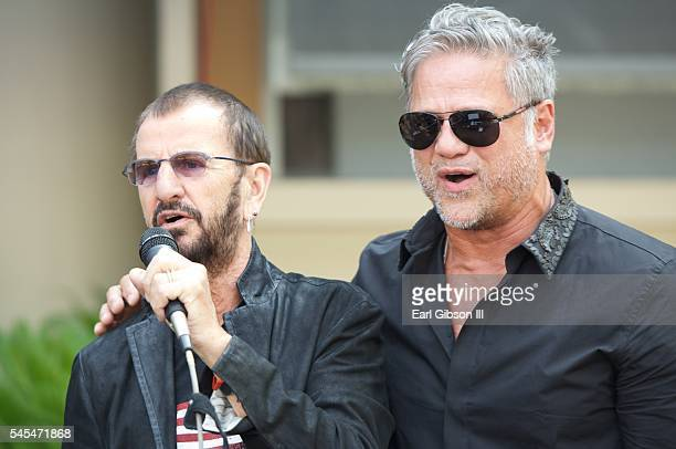 Musician Ringo Star and singer Jon Stevens perform at Ringo Starr's 'Peace and Love' birthday celebration on July 7 2016 in Hollywood California