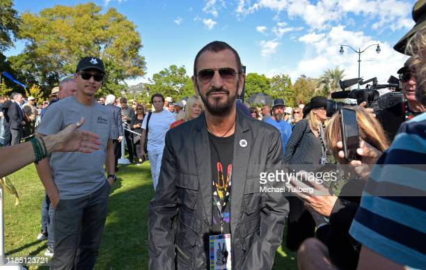 "Musician Ringo Starr attends a public art dedication for his donated sculpture ""Peace and Love"" at Beverly Gardens Park on November 02, 2019 in..."