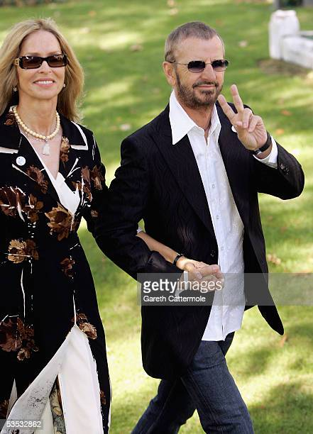 Musician Ringo Starr with wife Barbara Bach attend the wedding of musician Jools Holland and Christabel McEwen at St James's Church Cooling on August...