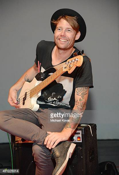 Musician Robbie G of musical group 'Deluka' performs onstage at the 'More Than a Cone' art auction and campaign launch benefiting Best Friends Animal...