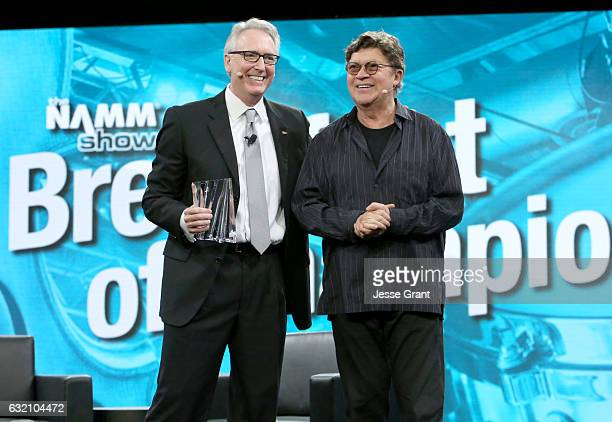 Musician Robbie Robertson receives the Music for Life Award from NAMM President and CEO Joe Lamond during the 2017 NAMM Show Opening Day at Anaheim...