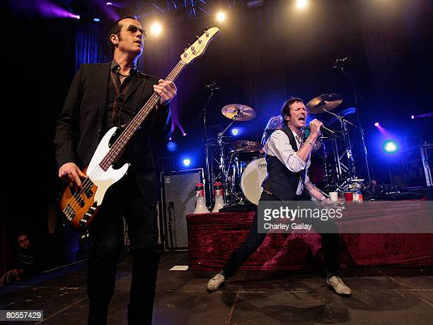 Musician Robert DeLeo and frontman Scott Weiland perform onstage during the Stone Temple Pilots tour announcement and performance held at a private...