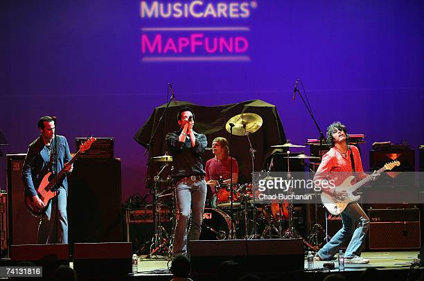 Musician Robert DeLeo of the Stone Temple Pilots Richard Patrick of Army of Anyone drummer Ray Luzier and Dean DeLeo of the Stone Temple Pilots...
